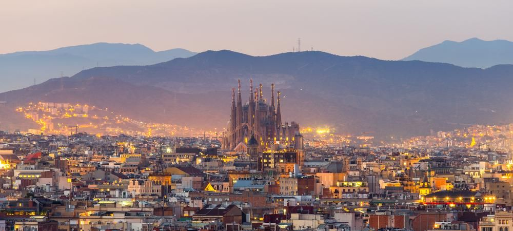 Aerial Panorama view of Barcelona city skyline and Sagrada familia at dusk time,Spain