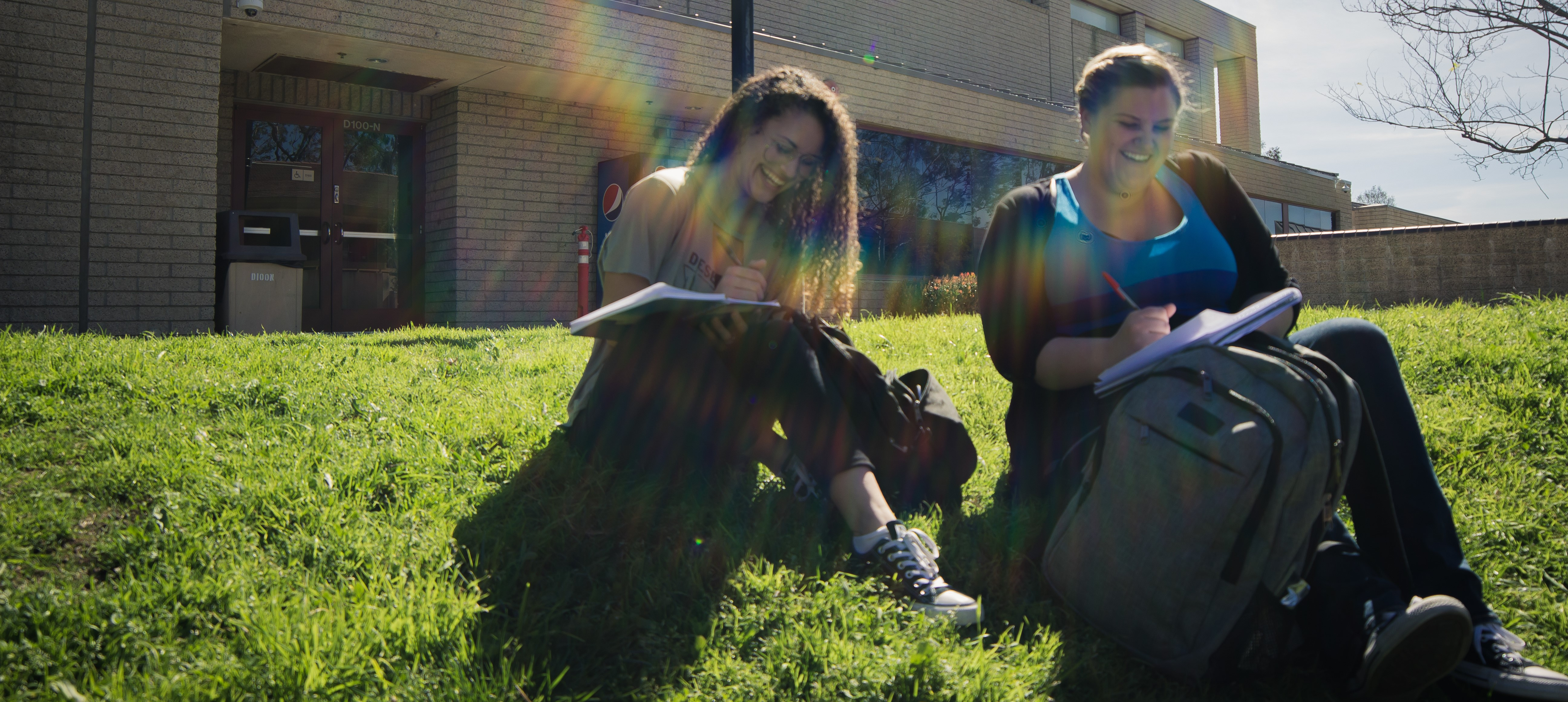 Two SCC students studying on the grass