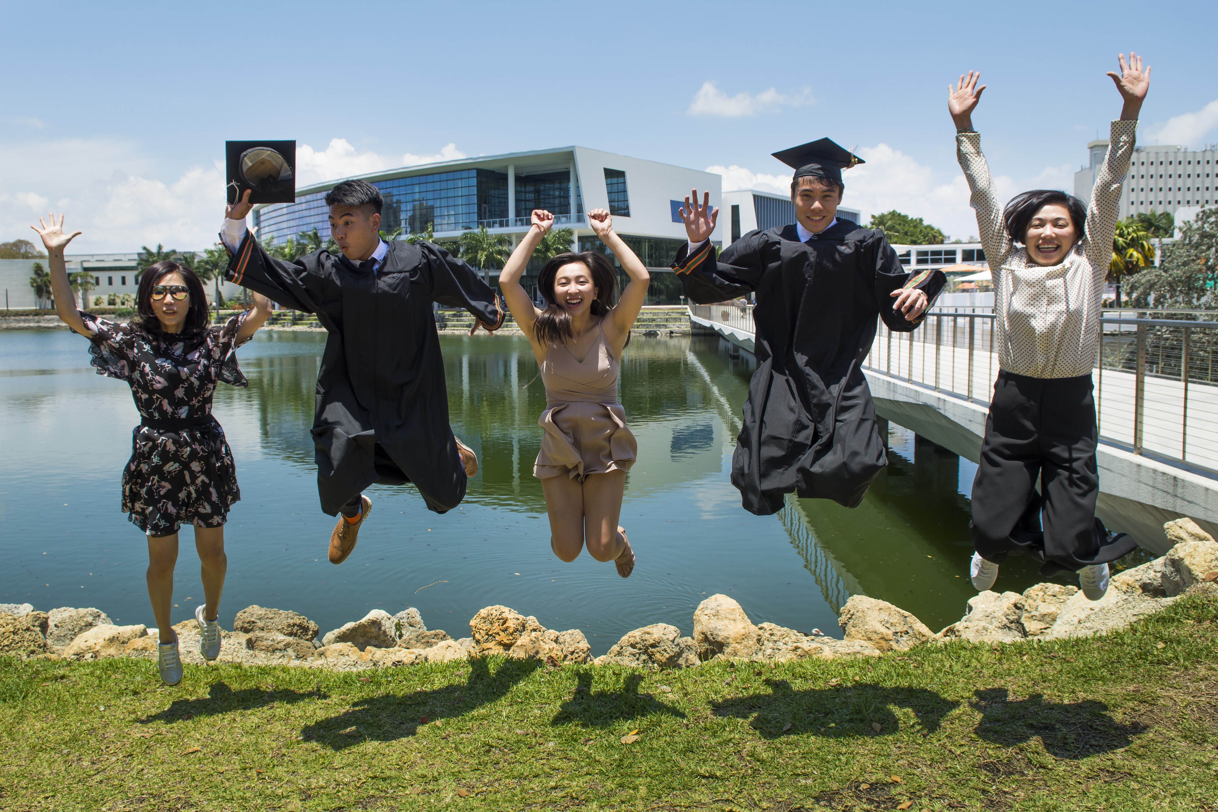 A group of students at the University of Miami celebrating their graduation.