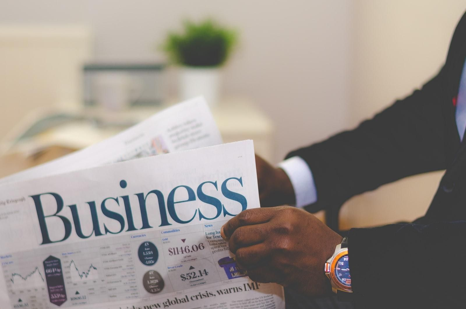 Businessman opening a paper