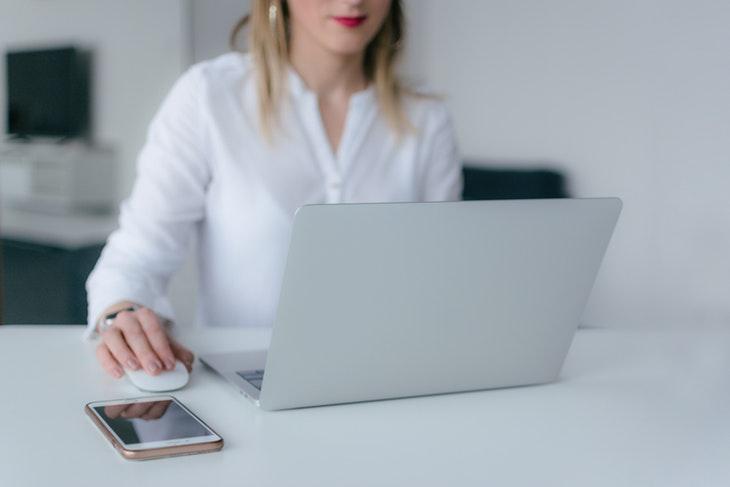 126742_woman-using-silver-laptop-2265488.jpg
