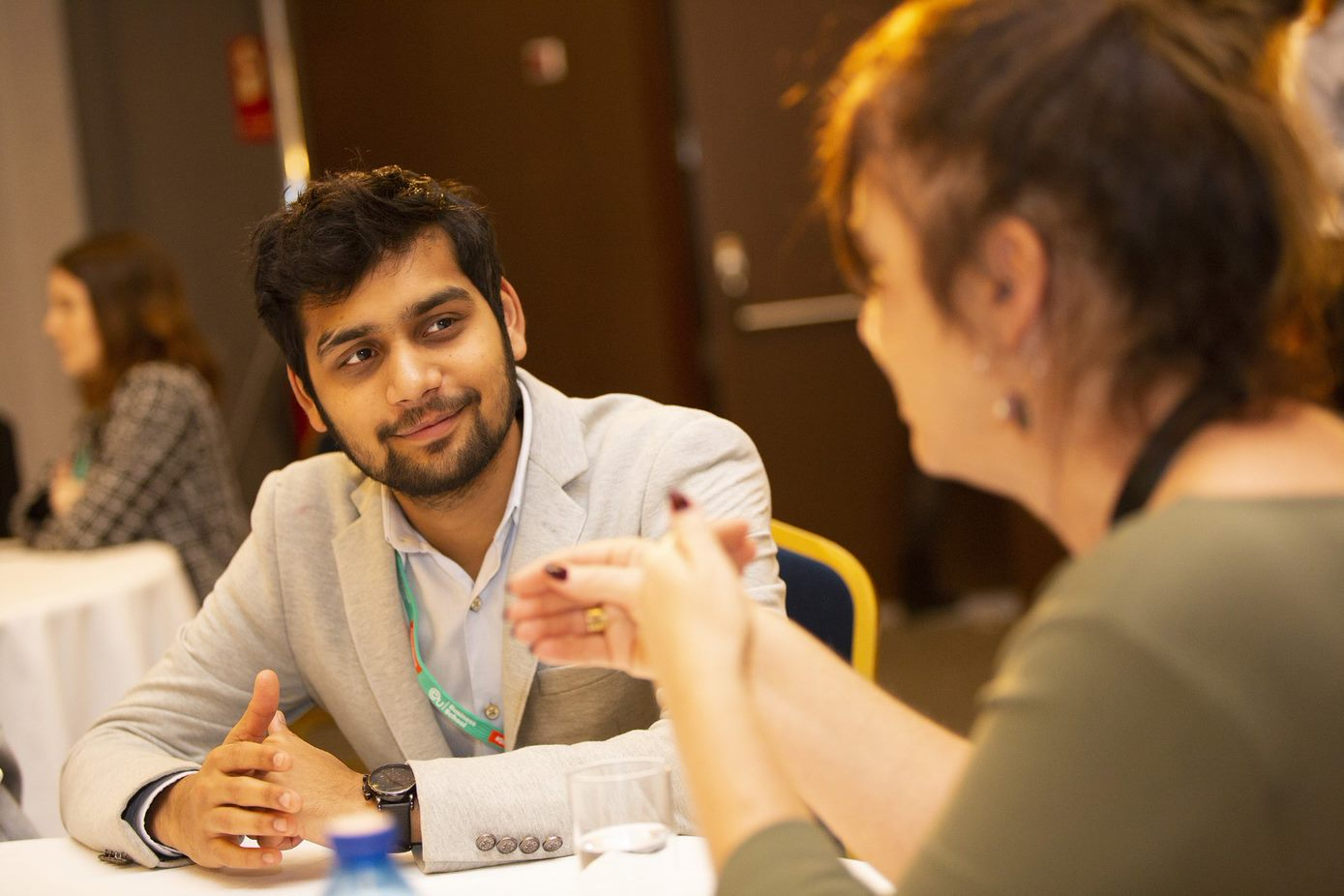 Business students talking at conference